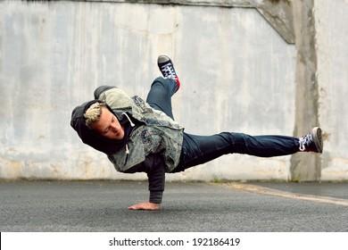 Teenager dancing breakdance in the street