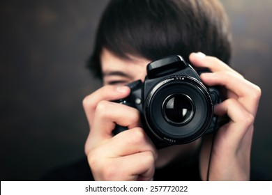 Teenager with digital compact camera