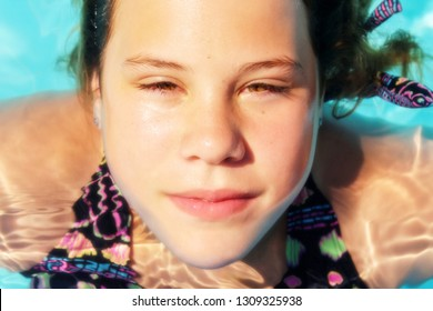 Teenager Diving In The Swimming Pool. Young Beautiful Dutch Girl Swimming In Pool On A Summer Day In Greece