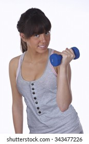 Teenager doing physical exercise with dumbbells