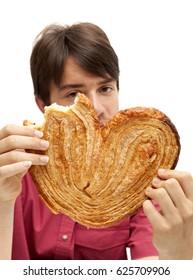 teenager eating eating huge palmerita cookie