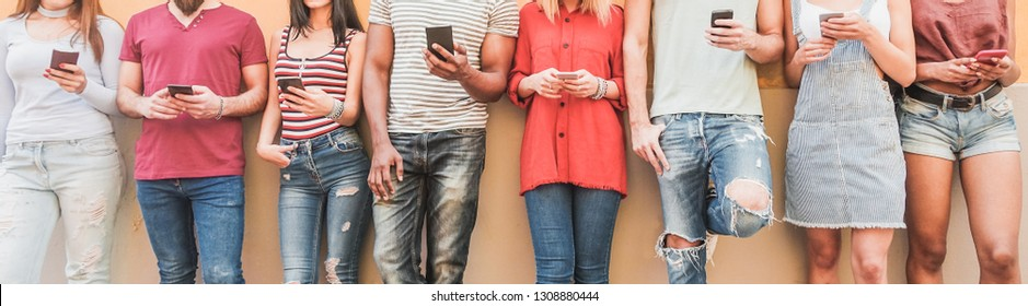 Teenager friends watching videos on smartphones  - Millennials generation addiction to new technology trends - Concept of youth, commute, tech, social and friendship - Main focus on center hands