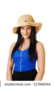 A teenager girl in a blue corset, black skirt and a straw hat standing for white background with her long black hair.