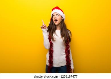 Teenager girl celebrating christmas holidays thinking an idea