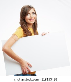 Teenager girl hold white blank paper. Young smiling woman show blank card. Girl with long hair portrait isolated on white background.
