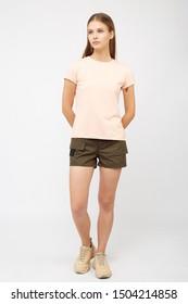 Teenager girl in khaki cargo shorts