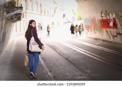 teenager girl with long brown hair street photo walk on grafiti wall background
