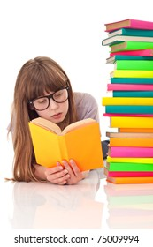 teenager girl lying on floor and reading next to pile of books, isolated