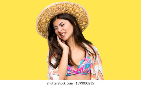 Teenager girl on summer vacation with toothache over isolated yellow background