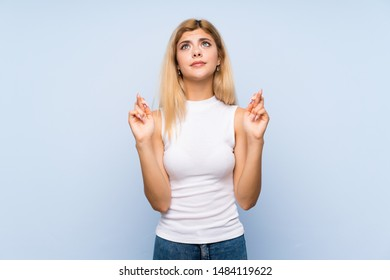 Teenager girl over isolated blue background yawning and covering wide open mouth with hand