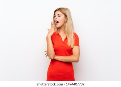Teenager girl over isolated white background yawning and covering wide open mouth with hand