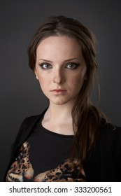 Teenager girl posing in a studio on a dark background