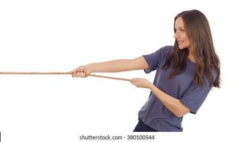 Teenager girl pulling a rope