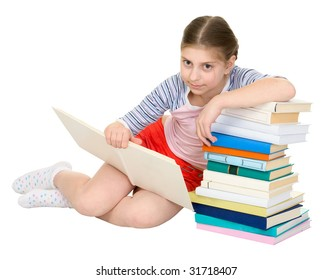 Teenager girl reading book and heap of books