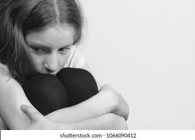 Teenager girl with red hair feeling lonely and scared looking sad and desperate suffering depression as victim of cyber bullying or social abuse violence and rejection