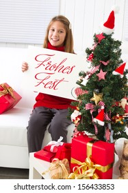 Teenager girl showing white paper, says Christmas celebration.