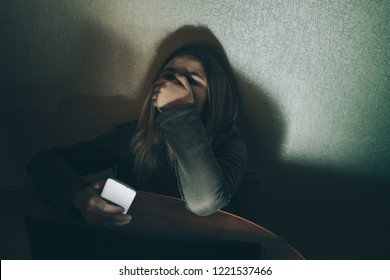 Teenager girl suffering internet cyber bullying scared and depressed cyberbullying. Image of despair humilated on internet by classmate. Young teenage  crying in front of the laptop