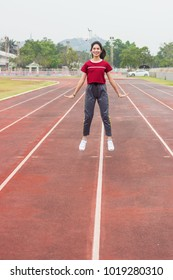 Teenager girl wear red sport cloth run on racetrack, jumping and exercise for health. Healthcare and sport concept. Free space for your text.