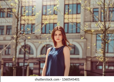 Teenager girl wearing hat standing on the city street looking camera serious