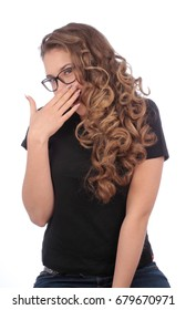teenager with glasses covering the mouth with her hand on white background