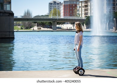 a teenager going through a rolling bridge on his hoverboard