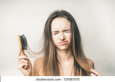 Teenager with hair comb,health care problems,sad,upset beauty face