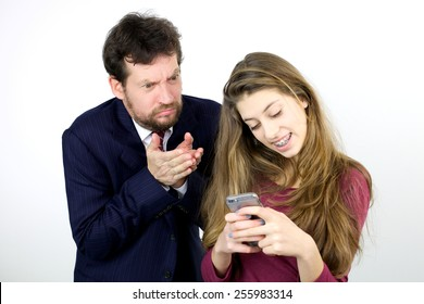 Teenager happy with cell phone father driving crazy