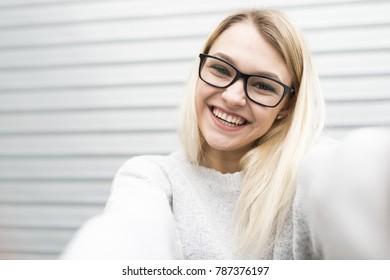 Teenager having fun, making selfies