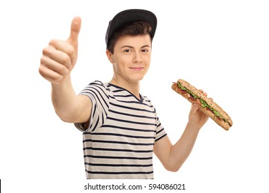 Teenager having a sandwich and making a thumb up sign isolated on white background