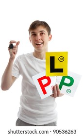 Teenager holding driving licence L and P plates for car.  He is also holding a car key and looking up at your messasge.
