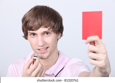 Teenager holding up a red card