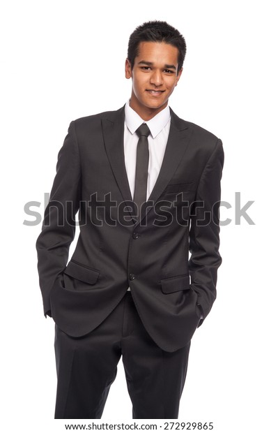 Teenager in impressive smart suit. Ready for job interview. Studio shot on white background.