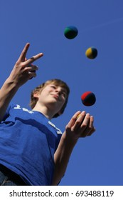 Teenager is juggling with balls