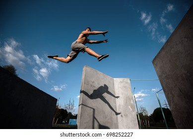 Teenager jump parkour on the walls