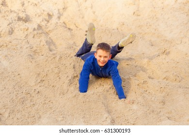 Teenager jumping against the beach. Parkour on the sand.
