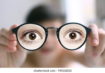 teenager kid boy in myopia eyes correction glasses close up portrait