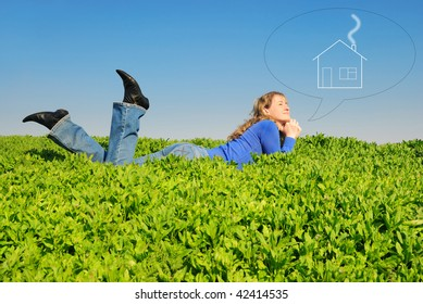 The teenager lays in a spring grass and dreams about home