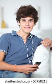 Teenager listening to music with mp3 player