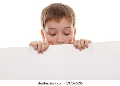 teenager looking down on a white board