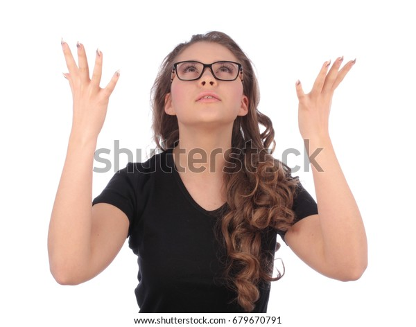 teenager looking up with open hands up on white background