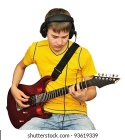 A teenager looks at a string electric guitar during the execution of works