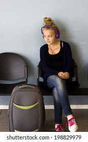 Teenager with luggage waiting for departure