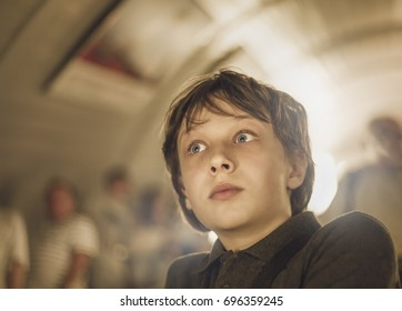 the teenager on the escalator during the descent into the subway
