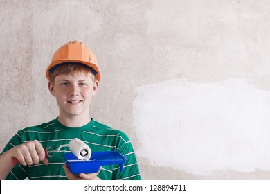 teenager painting the wall