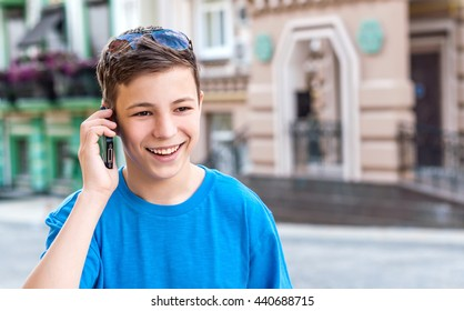teenager with the phone on the street town