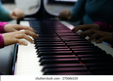 Teenager playing a piano, close-up on hands and keyboard. Rehearsal, school and discipline concept.