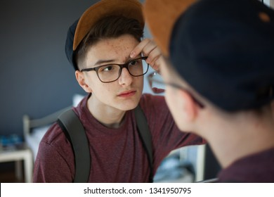 Teenager popping pimples