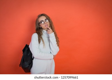 teenager portrait on red background with black bag