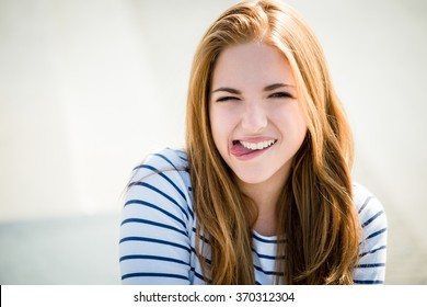 Teenager portrait - smiling girl outdoor on sunny day