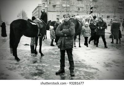 Teenager poses for the camera during New Year celebrations, Kamensk Shakhtinsky, Rostov region, circa 1996 (very grainy image)